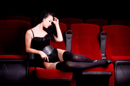Beautiful sexy woman in movie theater photo