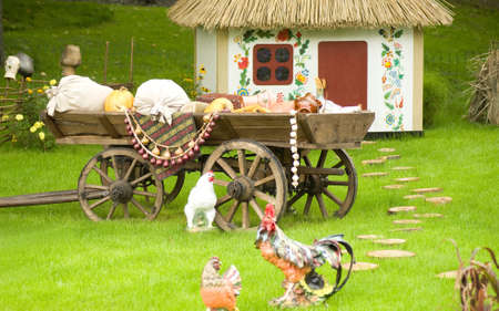 Beautiful rural cottage and vehicles or wagons in summer time  photo