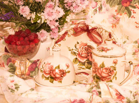 Vintage elegant tea set, flowers and raspberry photo