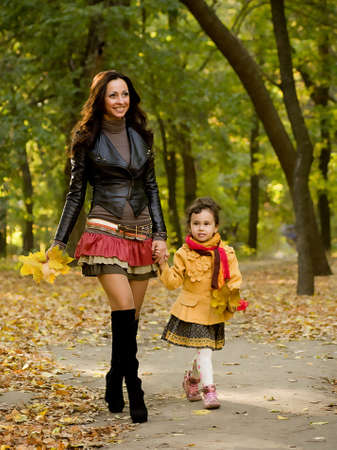 fetish wear: Funny little girl and mother in autumn forest
