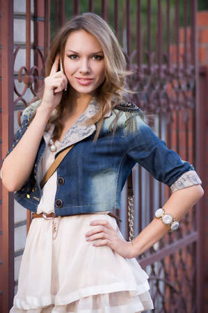Beautiful young woman in fashion clothes photo