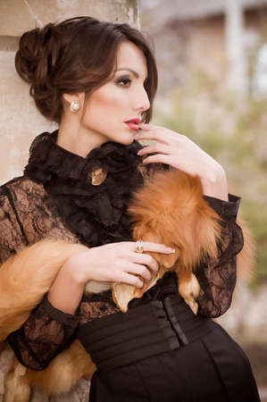 Beautiful young woman in vintage fashion clothes photo