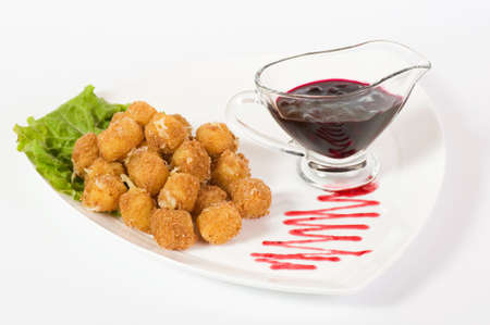 balls deep: Deep fried cheese balls and sauce Stock Photo