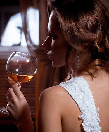 Beautiful bride with stylish make-up in white dress Stock Photo - 17064229