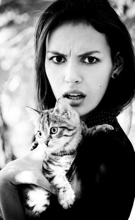 Surprised girl with a little cat Stock Photo - 17064278