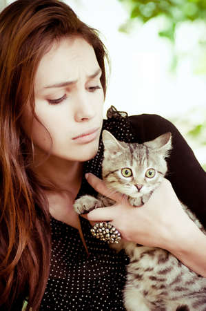 Surprised girl with a little cat Stock Photo - 17064574