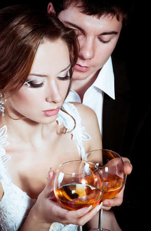 Bride and groom glass with vine glass on their wedding day Stock Photo - 16880444