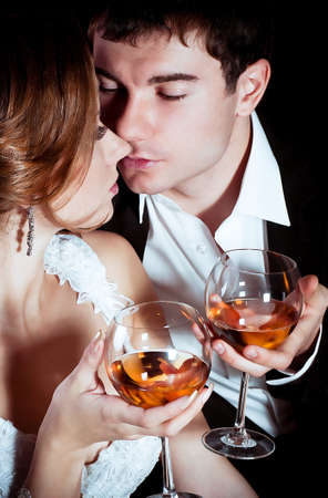 Bride and groom glass with vine glass on their wedding day Stock Photo - 16880449