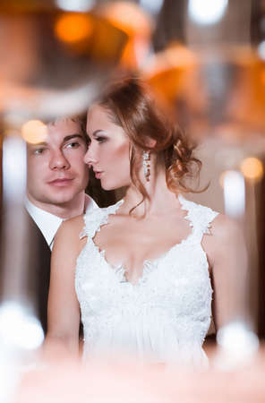 Bride and groom on their wedding day in a luxurious restaurant Stock Photo - 16880443