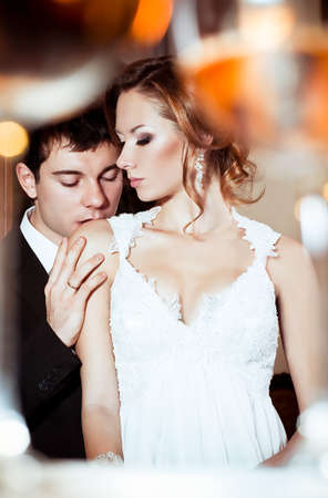 Bride and groom on their wedding day in a luxuus restaurant  Stock Photo - 16880447