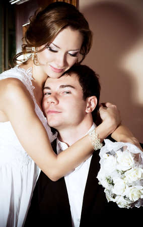 Bride and groom on their wedding day in a luxurious restaurant Stock Photo - 16880445