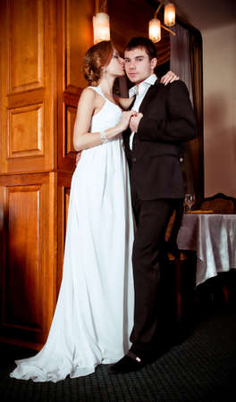 Bride and groom on their wedding day in a luxuus restaurant  Stock Photo - 16880448