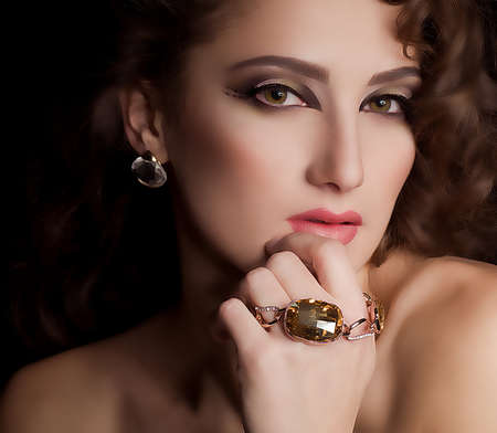 glimmer: Portrait of beautiful young woman with makeup in luxury jewelry