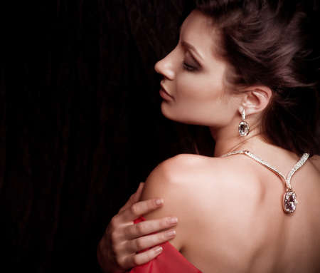 jewelry design: Portrait of beautiful young woman with makeup in luxury jewelry