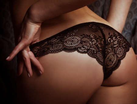 Woman s sexy buttocks in a bikini