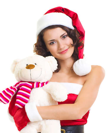 Beautiful girl in Santa Claus clothes with bear on white background  photo