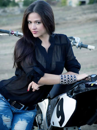 women jeans: Sexy beautiful girl with motorbike Stock Photo