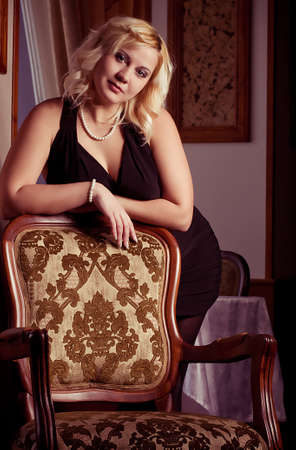 size: portrait of beautiful plus size young blond woman posing