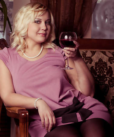 Portrait of beautiful plus size young blond woman posing