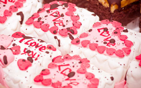 Small tasty cakes with hearts photo