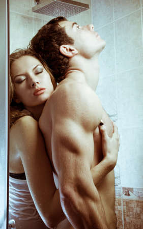 Loving couple engaged in love in a bath booth photo