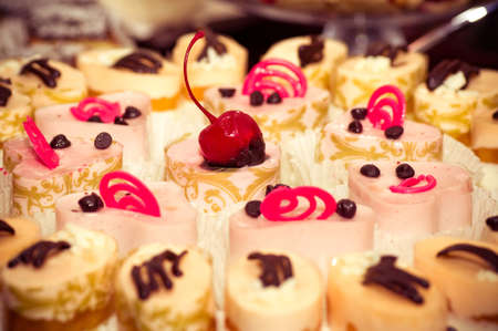 Small tasty cakes with cherry Stock Photo - 18854127