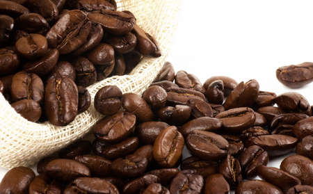 Coffee beans in canvas sack on white background photo