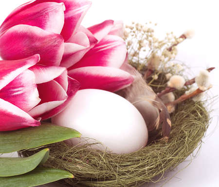 Easter eggs with bouquet pink tulips photo
