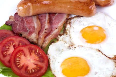 Breakfast with fried eggs with bacon and vegetables photo