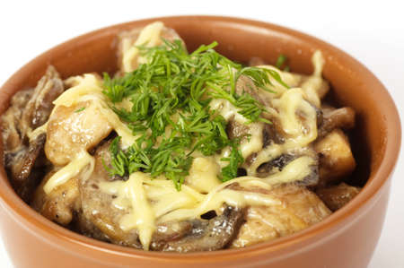 Bowl of chicken and roasted mushrooms photo