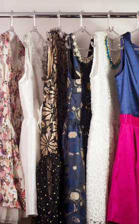 Color fashionable clothes in cloak-room photo