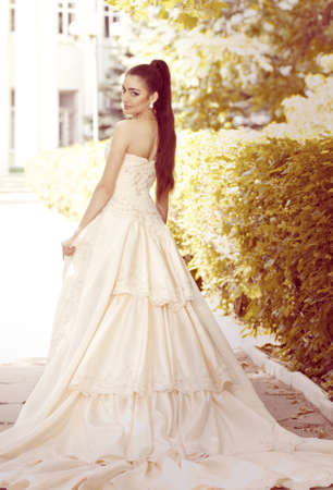 Beautiful bride with stylish make-up in white dress Stock Photo - 20419742