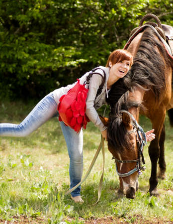 Young smiling woman with horse in the forest Stock Photo - 20405048