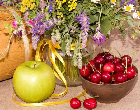 Flowers, apple and cherry on background photo