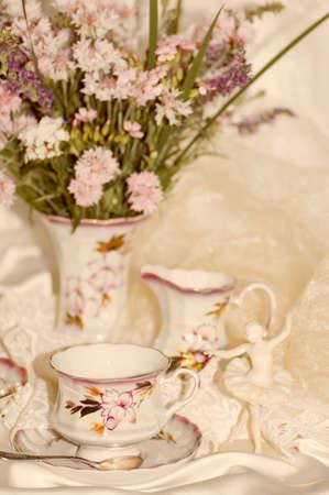 Vintage elegant cups and flowers photo