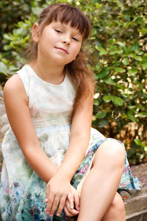 little happy girl in garden Stock Photo - 21225706