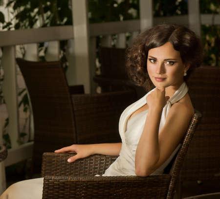 Beautiful bride with stylish make-up in white dress photo