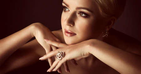 beautiful face: Portrait of beautiful young woman with makeup in luxury jewelry