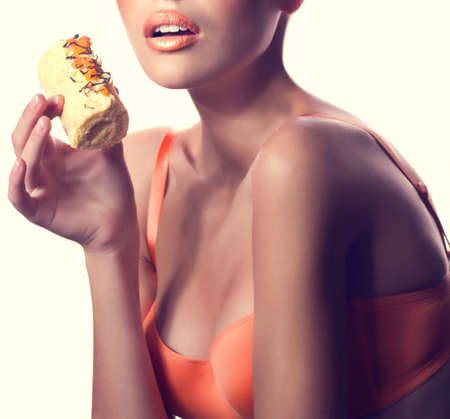 Beautiful fashion girl with delicious orange praline photo