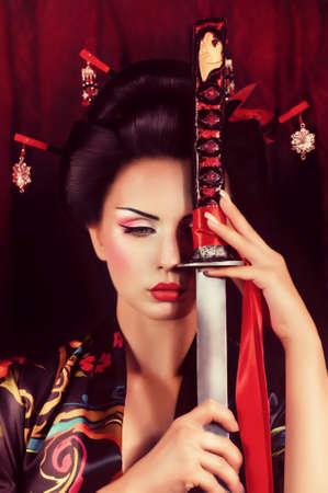 geisha kimono: Beautiful geisha in kimono with samurai sword