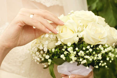 Bride with bouquet of flowers  Close up photo