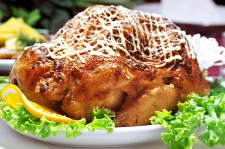Roast chicken with orange photo