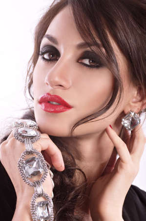 makeup face: Fashion woman with jewelry precious decorations