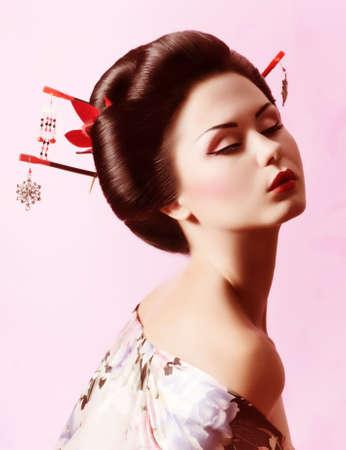 Portrait of a Japanese Geisha woman 版權商用圖片 - 26704076