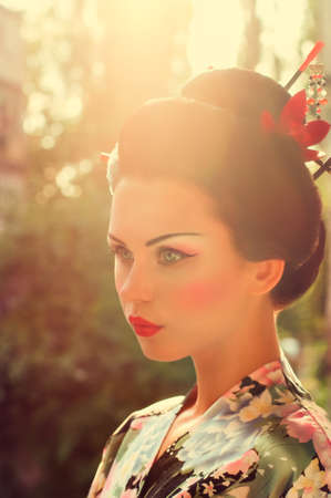 Portrait of a Japanese Geisha woman photo