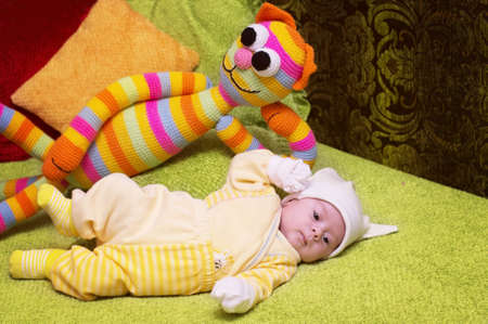 Cute funny infant baby with toy cat photo