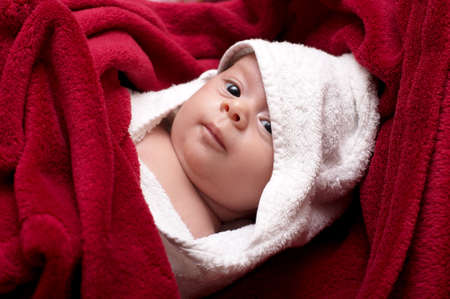 Beautiful baby in towel after bathing photo