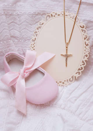 Baby shoe and card with golden cross for Christening photo
