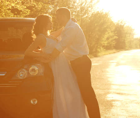 smiley face car: Bride and groom on their wedding day Stock Photo