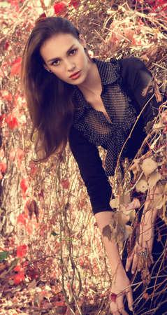 Beautiful girl in autumn garden Stock Photo - 30548817